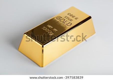 closeup of gold bullion on a light background - stock photo