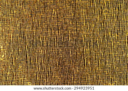 closeup of golden organza macro mesh texture - stock photo