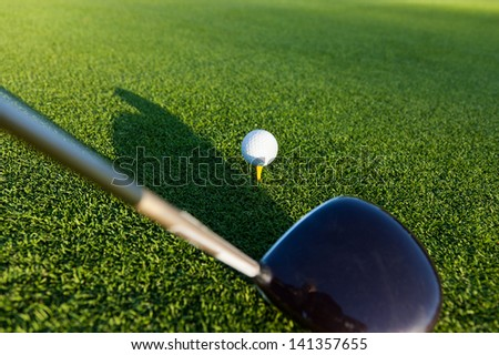 Closeup of golf club and ball - stock photo