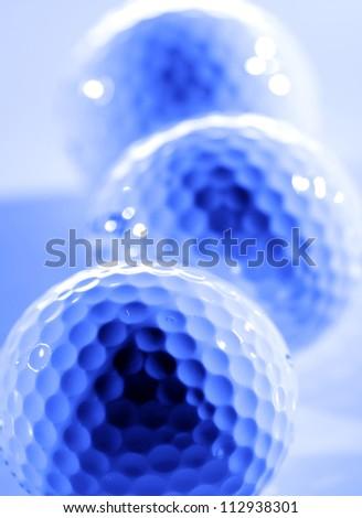 Closeup of golfballs with dark shadows - stock photo