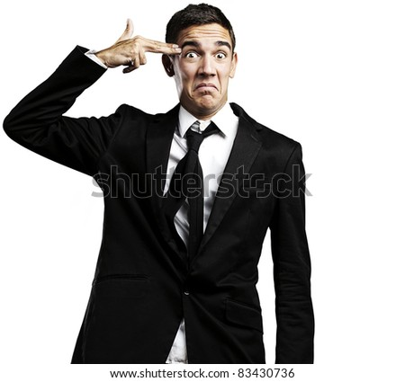 Closeup of good looking young man committing suicide with imaginary gun over white background - stock photo