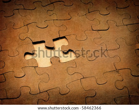 Closeup of grainy puzzle pieces with one missing - stock photo
