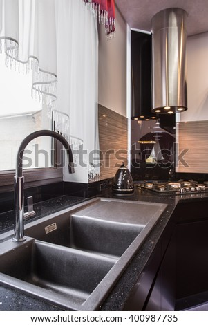 Closeup of granite sink in elegant kitchen