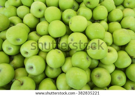 Closeup of green apples on a market - stock photo