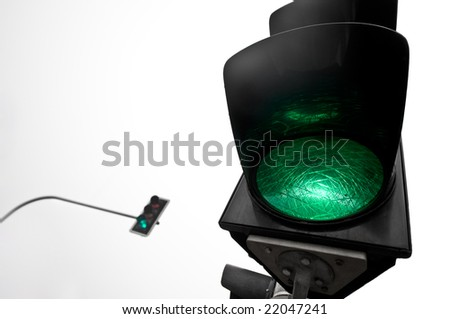 Closeup of green traffic lights with second ones in the background
