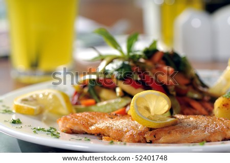 Closeup of Grilled Salmon Fillet with vegetables - stock photo