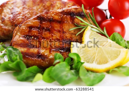Closeup of grilled steak with lemon and vegetable
