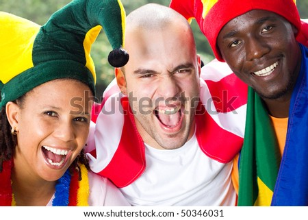 closeup of group of super fans of sports - stock photo