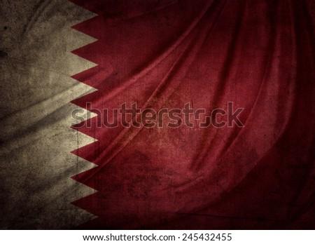 Closeup of grunge Qatar flag - stock photo