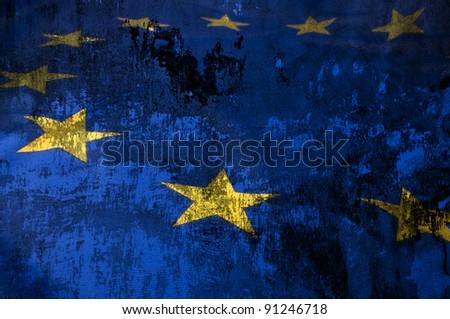 Closeup of Grungy Flag of European Union - EU Flag Drapery - stock photo