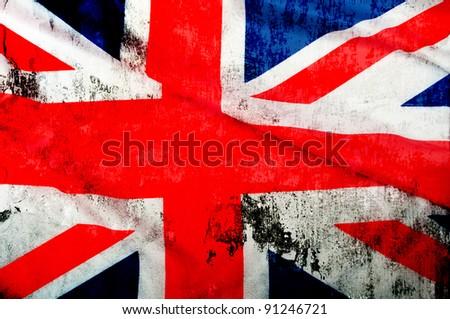 Closeup of Grungy Flag of Great Britain - UK Flag Drapery - stock photo