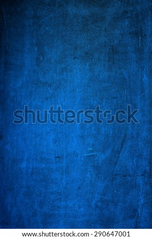 Closeup of grungy old blackboard/chalkboard in blue - stock photo
