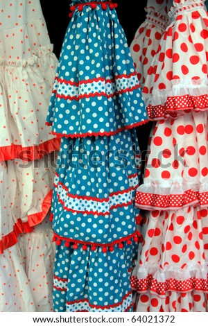 Closeup of gypsy skirts: closeup of  three colorful & frilly gypsy skirts for sale. - stock photo