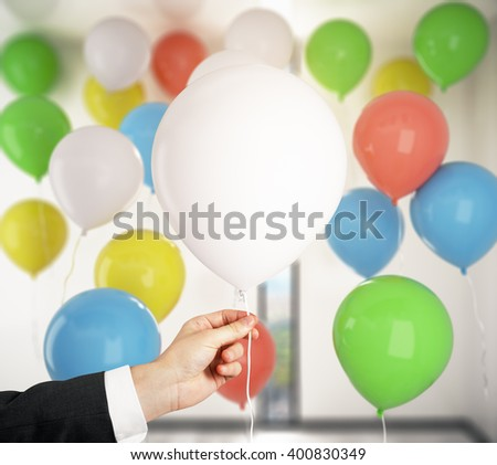 Closeup of hand holding blank white balloon with many colorful balloons in the background. Mock up, 3D Rendering - stock photo