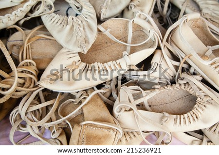 Closeup of hand-made traditional leather shoes for villagers - stock photo