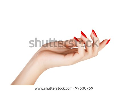 closeup of hand of a young woman with long red manicure on nails against white background - stock photo