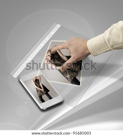 closeup of hand touching screen on futuristic tablet - stock photo