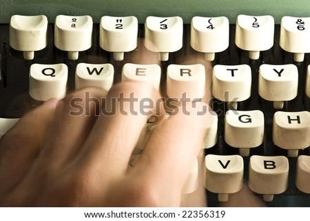 closeup of hand writing on a typewriter - stock photo