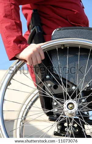 Closeup of handicapped woman on wheelchair - stock photo