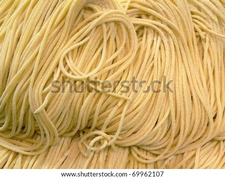 Closeup of handmade fettuccine pasta - stock photo