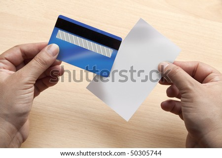 Closeup of hands holding a blank credit card and receipt ready to add any data