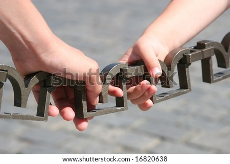 Closeup of hands holding a chain