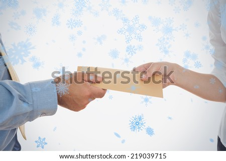 Closeup of hands holding bribe against snow falling - stock photo