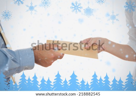 Closeup of hands holding bribe against snowflakes and fir trees in blue - stock photo