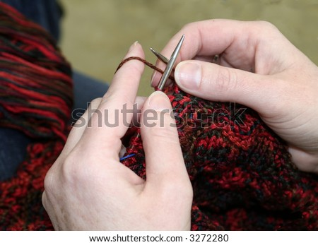 Closeup of hands knitting - stock photo