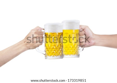 Closeup of hands making a toast with glasses of beer, isolated on white background. - stock photo