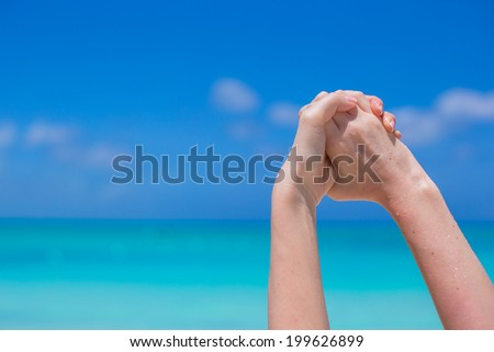 Closeup of hands making handshake background turquoise water