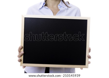 closeup of hands of a young business woman standing holding a blackboard isolated on a white background - focus on the blackboard - stock photo