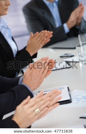 Closeup of hands on business meeting at office clapping