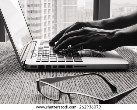 Closeup of hands typing in a office setting  - stock photo