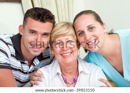 closeup of happy a senior mother and her kids - stock photo