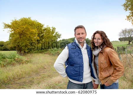 Closeup of happy couple in autumn - stock photo