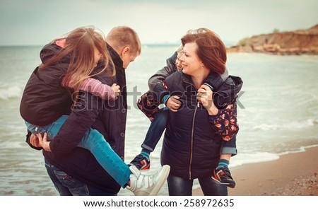 Closeup of happy family at the beach - stock photo