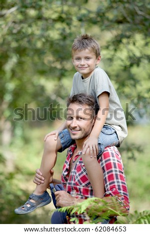 Closeup of happy father and son - stock photo
