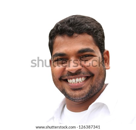 Closeup of happy handsome young business man expressing confidence and positive attitude in relaxed style. The young adult's photo is isolated on white background and is of indian origin