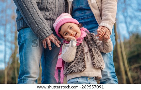 Closeup of happy little girl enjoying with her fathers of leisure in the forest. Family time concept. - stock photo