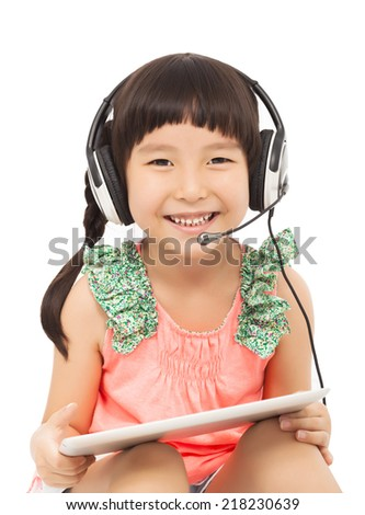 closeup of happy little student girl holding a tablet with earphone. isolated on white background - stock photo