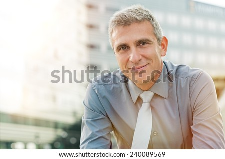 Closeup Of Happy Mature Businessman Smiling Outdoor - stock photo
