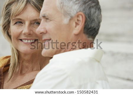 Closeup of happy middle aged woman looking at man in Rome; Italy - stock photo