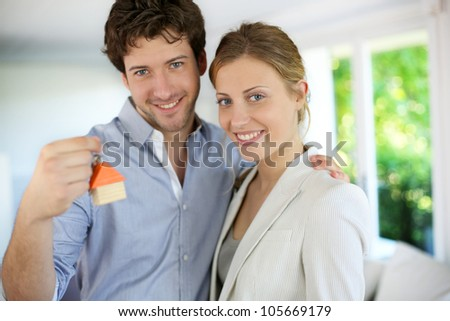 Closeup of happy new property owners - stock photo