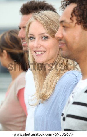 Closeup of happy student standing outside - stock photo