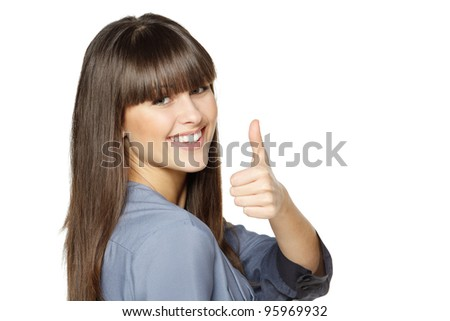 Closeup of happy woman showing thumbs up gesture on white background - stock photo