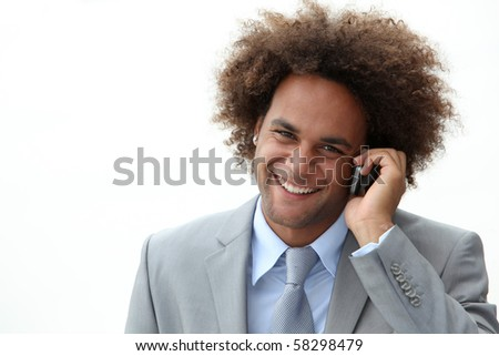 Closeup of happy young businessman on the phone - stock photo