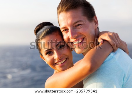 closeup of happy young couple on cruise