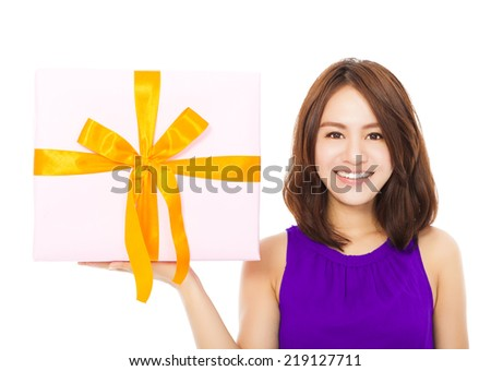 closeup of happy young woman holding a gift box over white background - stock photo