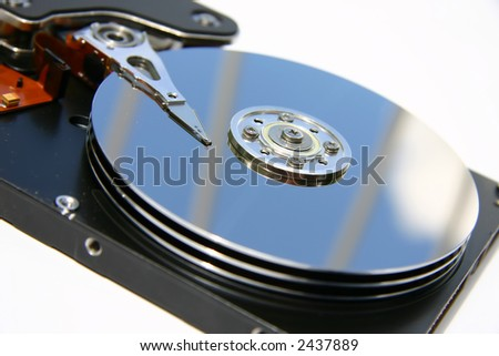 Closeup of hard drive with sky reflecting on a white background